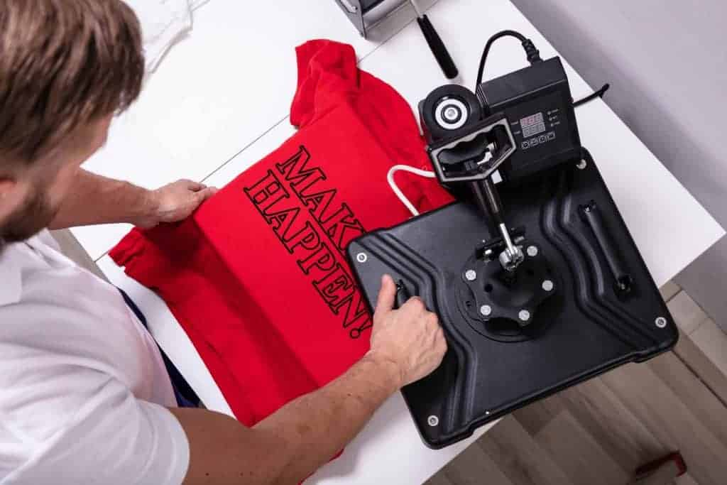 man printing a shirt for a print on demand store