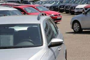 a line up of cars at a used car lot