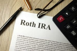 A piece of paper with Roth IRA written on it as well as the definition of what a Roth IRA is