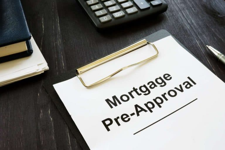 A piece of paper on a clipboard that reads Mortgage Pre-Approval