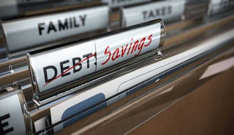 Folders originally labelled Debt, crossed off and now label savings after paying off debt