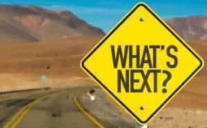 "Road sign saying ""What's next?"""