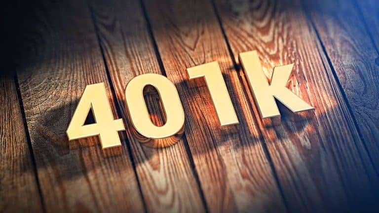 401k written n gold on a table