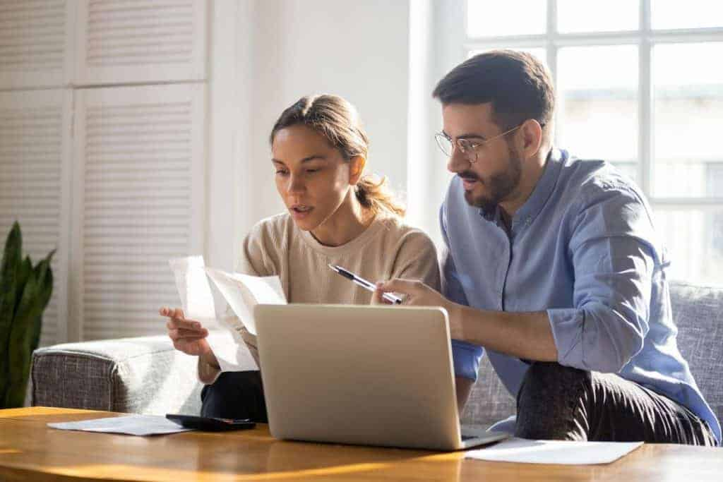 Husband and Wife going over their finances to get on the same page about money
