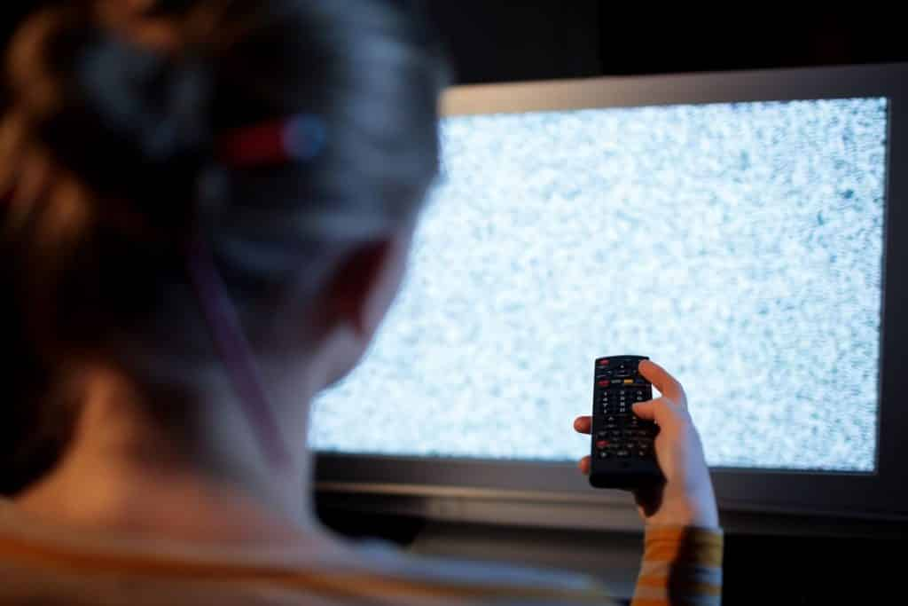 Woman turning off tv to do other things