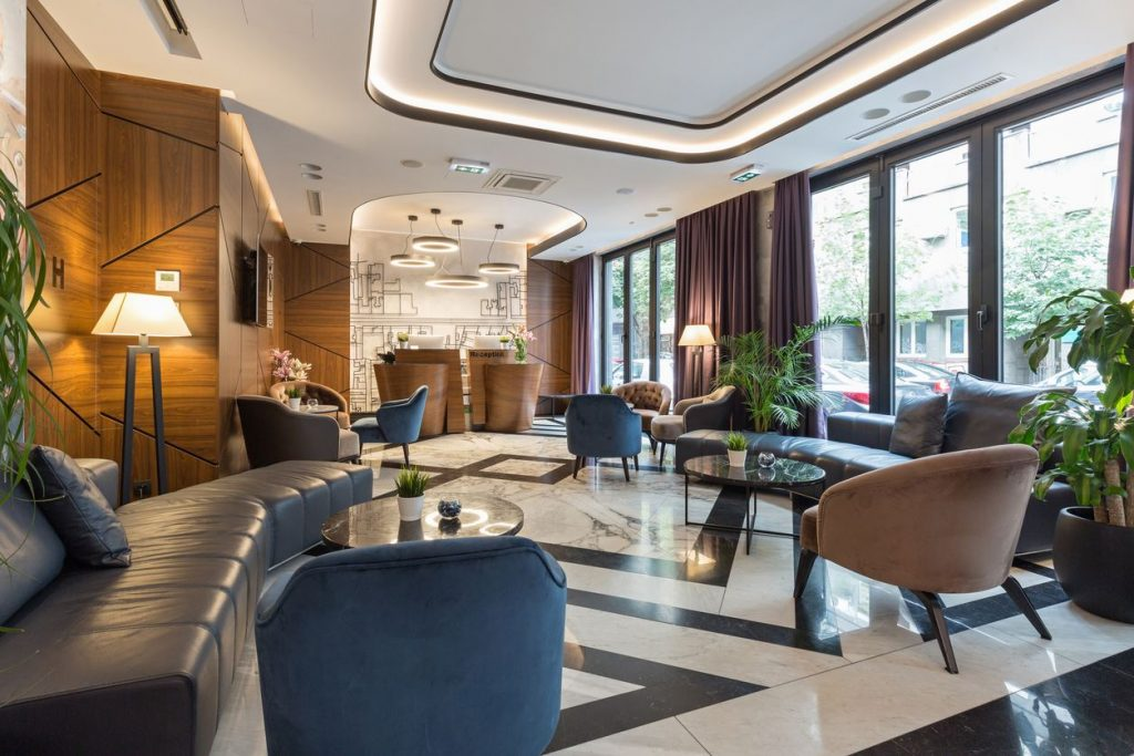 fancy decorated hotel lobby where someone will save money when staying at