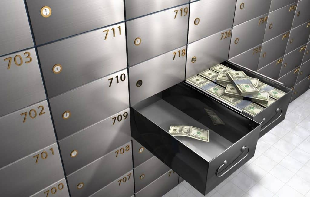 Money in a safe deposit box demonstrating the importance of saving money