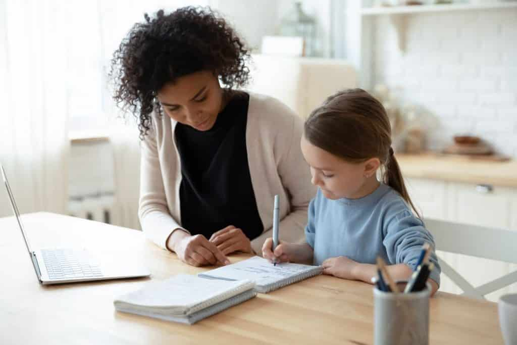 Woman tutoring a child after charging her parents an appropriate amount