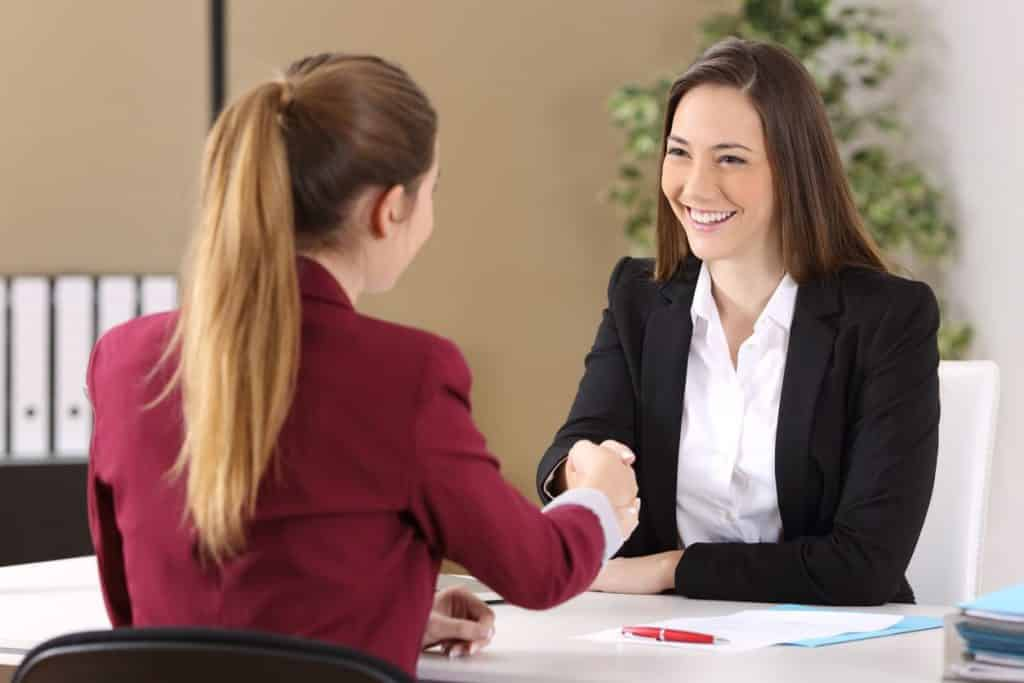 Woman bringing the right things to a job interview and being interviewed by another woman